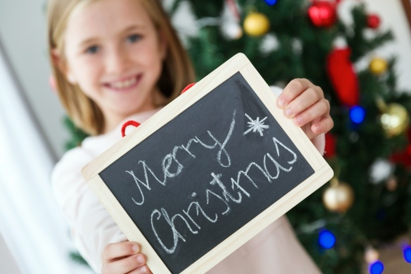 girl-with-a-merry-christmas-poster-free-photo