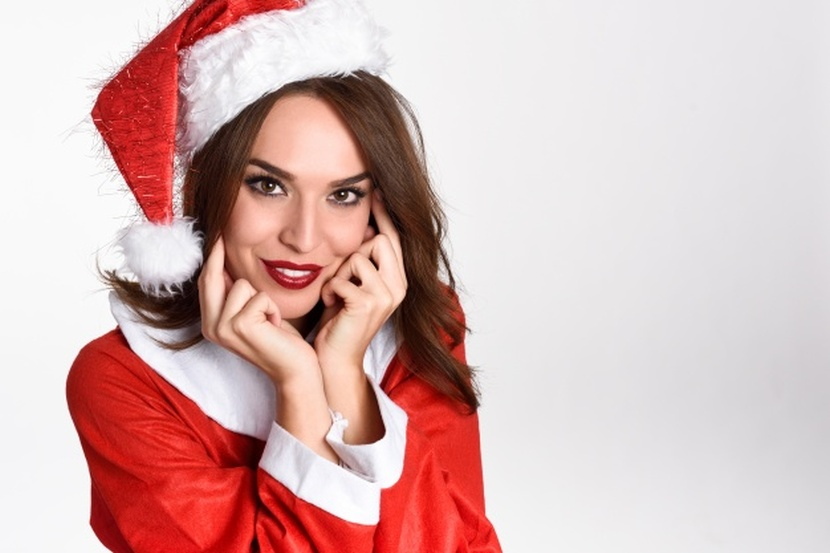 woman-wearing-santa-claus-clothes-looking-at-camera-free-photo